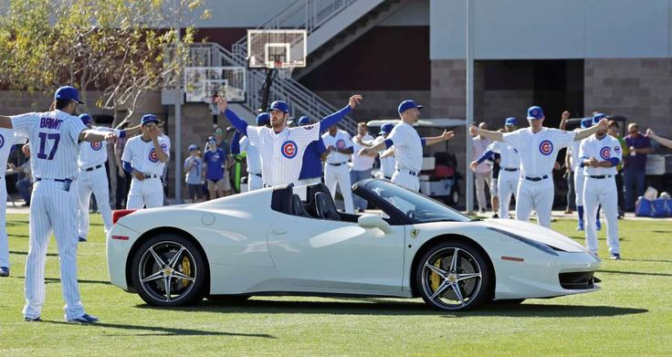 2017 spring training:     Sharing the field:    Cubs players get their stretches in around a Ferrari parked on their field Feb. 21 in Mesa, Ariz.