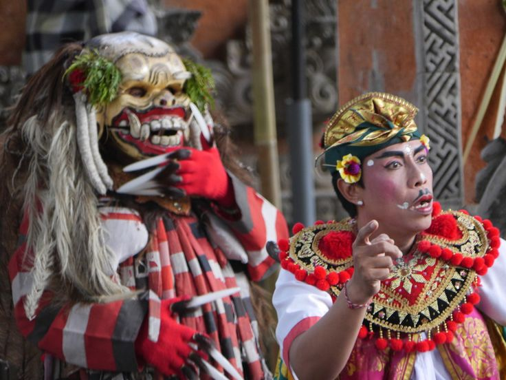 Sahadewa Barong and Kris Dance, Bali, Indonesia - Rangda is an evil demon queen (the thing with teeth) that can be seen below sneaking up on one of the servants of Dewi Kunti.