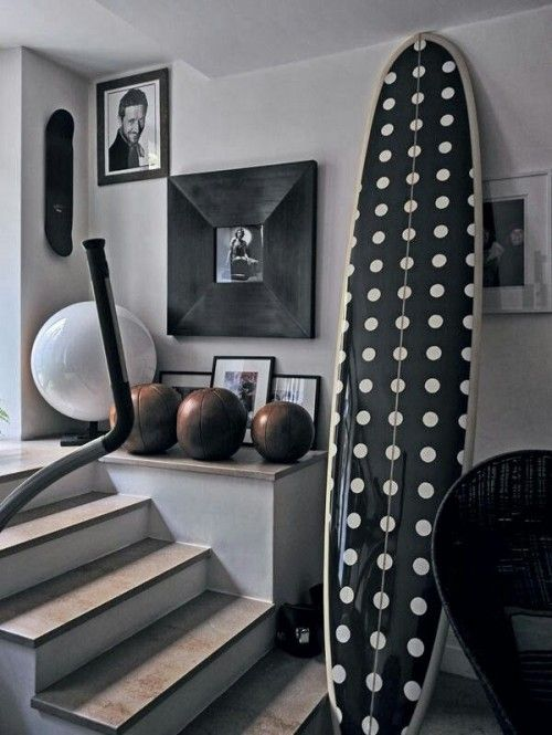 white walls, stairs, surfboard