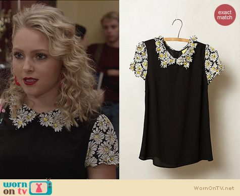 Carrie's black top with daisy applique on The Carrie Diaries. Outfit Details: http://wornontv.net/23169 #TheCarrieDiaries #Anthropologie