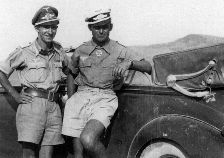 Oberstleutnant and Luftwaffe flying ace Heinz Bär and Luftwaffe pilot Armin Köhler with a captured Chevrolet Cabriolet Convertible while operating in Africa during 1941