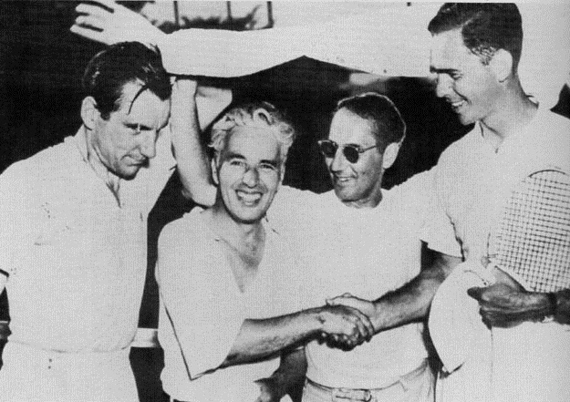 From left, Fred Perry, Charlie Chaplin, Groucho Marx and Ellsworth Vines during a celebrity tennis match set up for the opening of a new club house. The match was doubles, The Americans (Marx and Vines) vs The English (Chaplin and Perry).