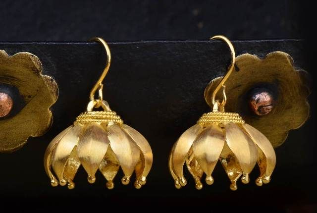 Flower Blossom Jhumki - The flower blossom is carefully handcrafted in 22k gold and depicted in the form of the Indian jhumki.
