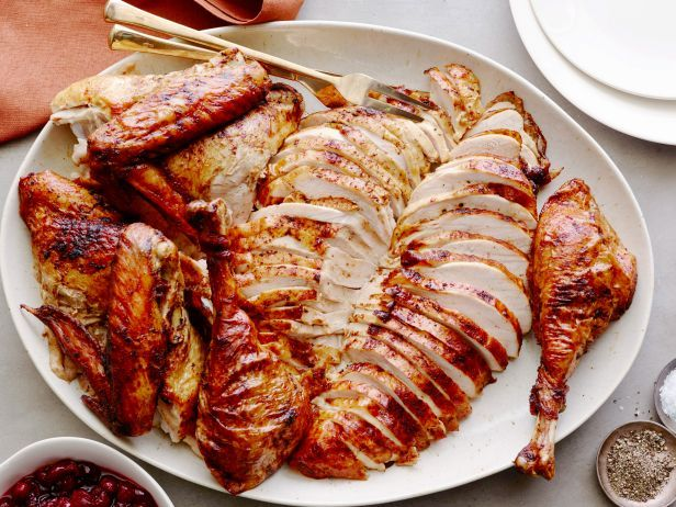 Cajun Brined Turkey — Two Ways : Bobby treats two turkeys to a fragrant brine and spice rub. When it's time for roasting, one turkey cooks in a Cuban-style box for smoky results and the other in a green ceramic grill using smoked wood chips for bold hickory flavor.
