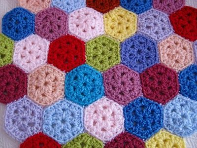 Mini Hexagon, free pattern from Bunny Mummy.  Great for small scraps, with some really interesting possibilities.   . . . .   ღTrish W ~ http://www.pinterest.com/trishw/  . . . .   #crochet #motif