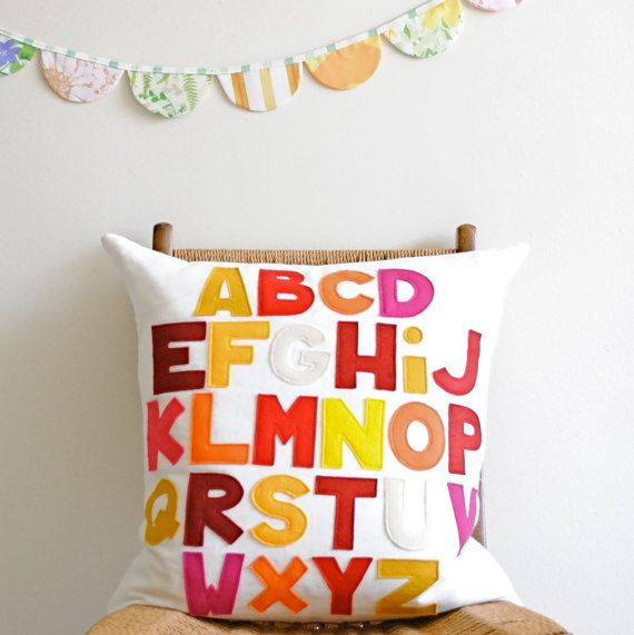 Alphabet Pillow, $110 by Pillow Factory on etsy - love this! so colourful and beautifully made