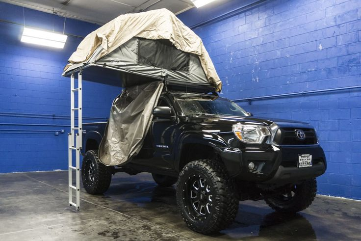Lifted 2015 Toyota Tacoma 4x4 Truck with Custom Tent Roof Rack