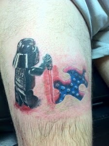 This may not be beautiful to you, but to me it embraces my son.  I found this tatoo online.  Darth Vader is light sabering an autism puzzle piece revealing a Lego.  This was for his son, but has capture mine perfectly.