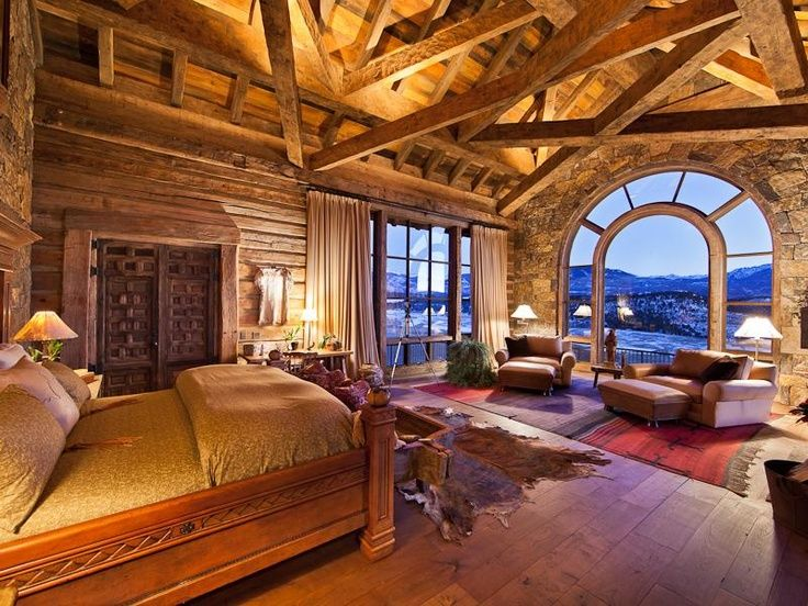 What a view in this rustic cabin bedroom