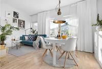 1-room-with-blue-sofa-and-dining-table-round