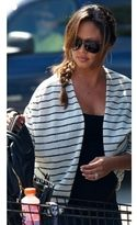 vanessa minnillo  Who made  Vanessa Minnillos black and white stripe jacket and black handbag?