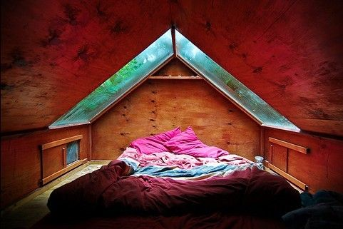 Special room in the attic for rainy days and starry nights...this would be amazing