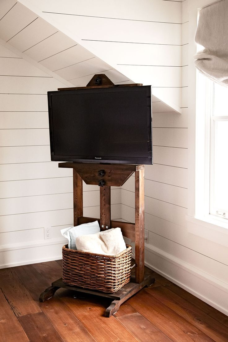 hidden-TV-cables-with-Restoration-Hardware-easel-and-wicker-basket: