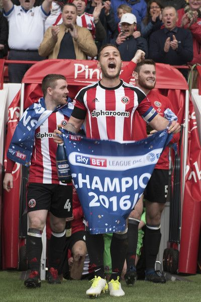 SHEFFIELD, ENGLAND- APRIL 17: Billy Sharp of Sheffield United celebrates winning promotion to the Sky Bet Championship after the Sky Bet League One match between Sheffield United and Bradford City at Bramall Lane on April 17, 2017 in Sheffield, England.