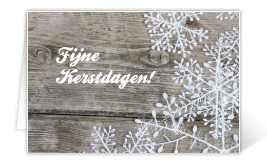 Christmas card with wooden background and frost flowers