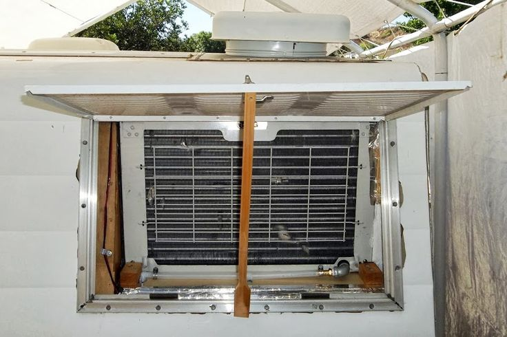 I installed a small window air conditioner in an upper cabinet at the rear of my Aristocrat.  I mounted it high because cold air settles, and also so I could vent it through the roof.  All went