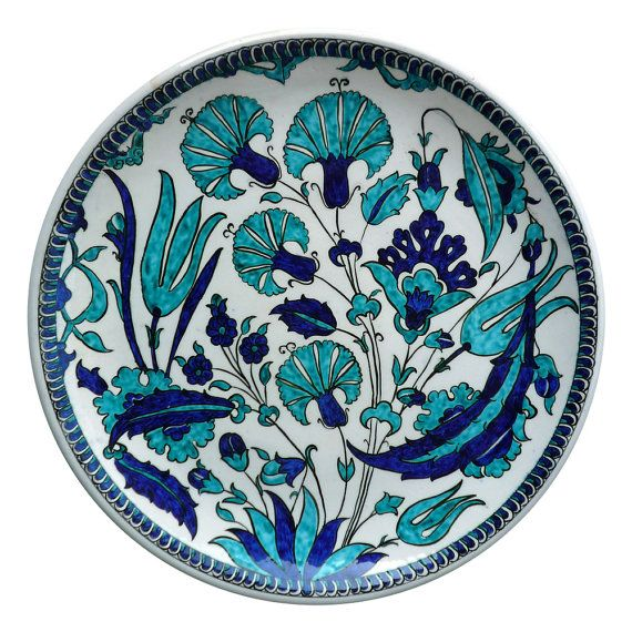 An Iznik Pottery Dish with cobalt and turquoise tulips and carnations