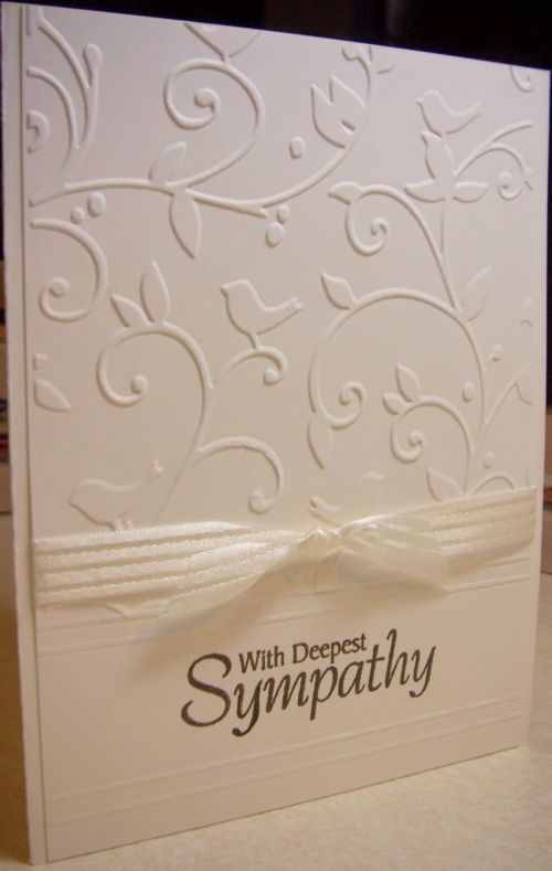 use embossing folder and score lines. w white ribbon