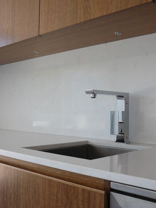 Smartstone Carrara 014250 benchtop/ splashback,Spotted gum veneer satin doors and panels, LED lights. - Pete Interiors, Kitchen Renovation, Newport, NSW, 2106 - TrueLocal