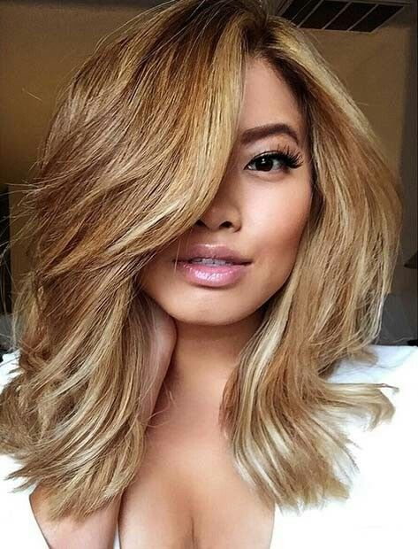 HONEY BLONDE LOB WITH LONG SIDE BANGS If you're having your lob cut for the first time, you should definitely get it cut whilst in a centre-parting. By doing this, you can play around a lot more than what you would get to do if you had it styled and cut with a side-parting.