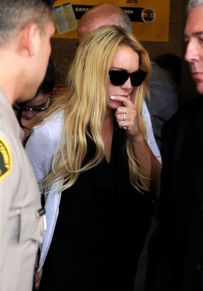 Lindsay Lohan Photos Photos - Actress Lindsay Lohan leaves Beverly Hills Courthouse after being found in violation of probation and will return to surrender July 20, 2010 at the Beverly Hills Courthouse on July 6, 2010 in Los Angeles, California. Lindsay Lohan was put on probation for her August 2007 no-contest plea to drug and alcohol charges stemming from two separate traffic accidents, but the probation was revoked in May 2010 after missing a scheduled hearing. - Lindsay Lohan Probation…