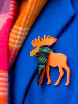 Moose Brooch in a Tartan scarf in Orange. By KiviMeri Finland.