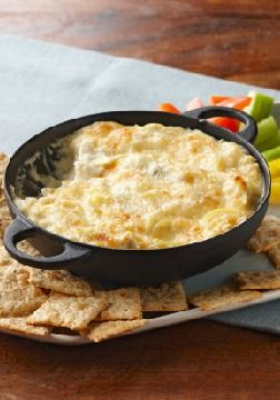 Hot Artichoke Dip – In our experience, this cheesy hot artichoke dip goes fast!