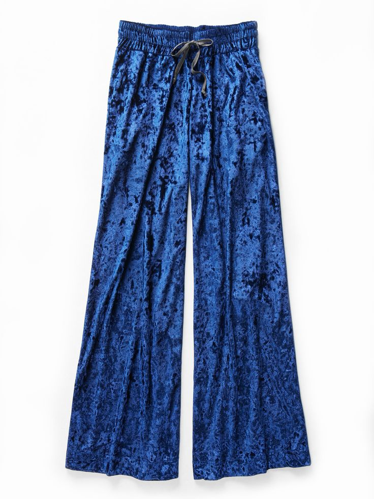 Palazzo! Palazzo! Pant | Ultra cool palazzo style pants with a dramatic flare in a gorgeous velvet fabrication. Waist features a stretchy smocked band with an adjustable drawstring for a comfy fit. Side pocket details.