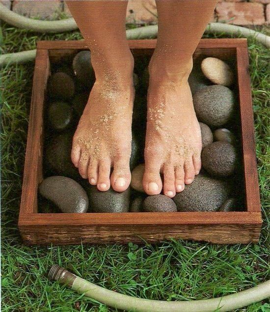 Rocks in a box + garden hose = clean feet what a great garden idea! Placed in the sun will heat the stones as well. Great way to wash off feet covered with grass ^ dirt before coming inside. ^
