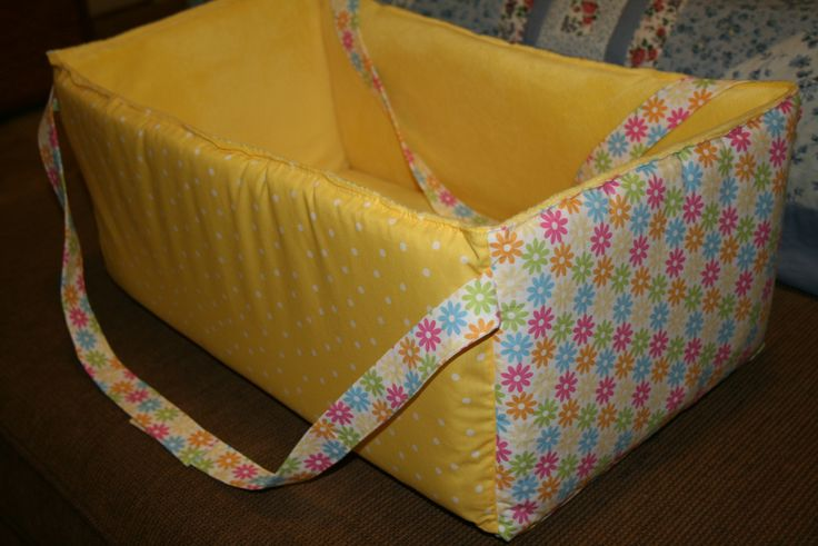Infant travel bed which can be used as a soft sided toy box for later. Detailed info on how to make this DIY baby nursery project from a couple of yards of fabric and batting.