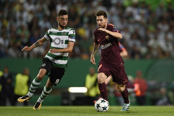 Bruno Fernandes of Sporting CP competes for the ball with Lionel Messi of FC Barcelona during the UEFA Champions League group D match between Sporting CP and FC Barcelona at Estadio Jose Alvalade on September 27, 2017 in Lisbon, Portugal.
