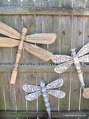 Repurposed Table Leg & Ceiling Fan Dragonflies....great backyard or garden fence decor.