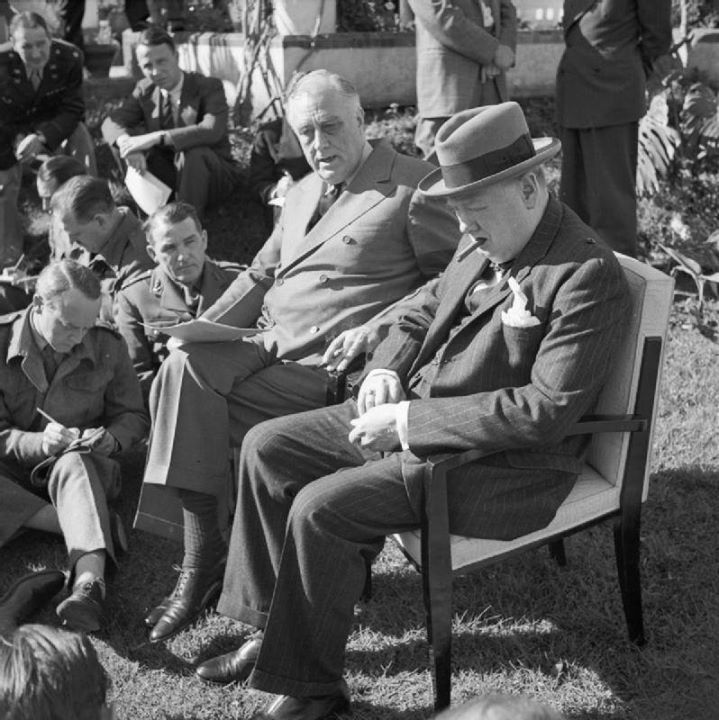 Franklin Roosevelt and Winston Churchill brief war correspondents in the gardens of Roosevelts Villa Dar es Saada in the Anfa neighborhood of Casablanca French Morocco during the Casablanca Conference 24 January 1943.