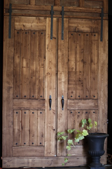 These stunning wood doors were handcrafted by a local carpenter to cover the unsightly arena doors and added the perfect touch in welcoming guests to the vintage inspired event.