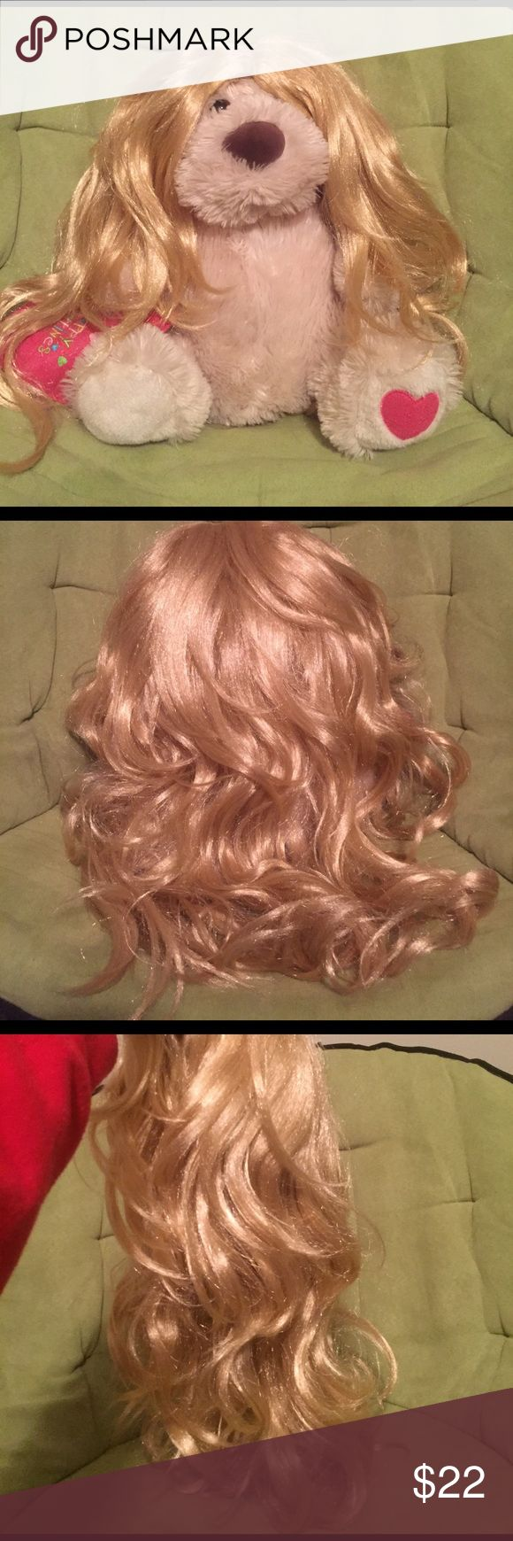 Long curly blonde wig NWOT. Bought for a Halloween costume but never worn it. Long blonde curls. Comes with free bald cap. Other