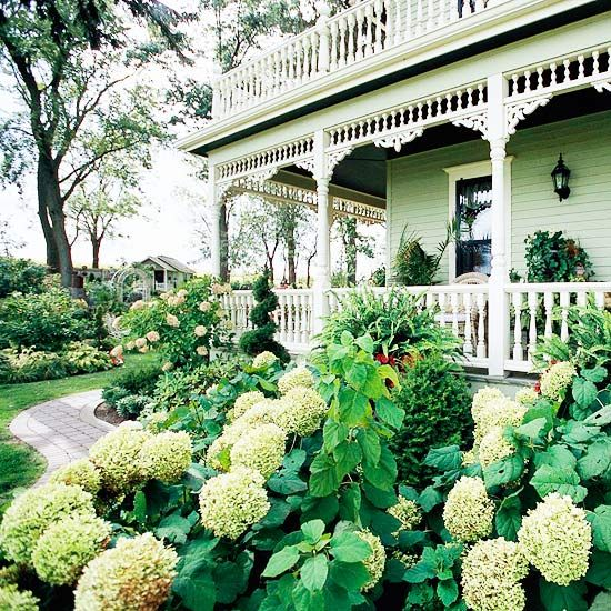 28 Beautiful Small Front Yard Garden Design Ideas...  hydrangeas and gingerbread trimmed Victorian house; beautiful!