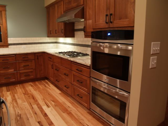 23 best images about kitchen on pinterest for Hardwood floors with oak cabinets
