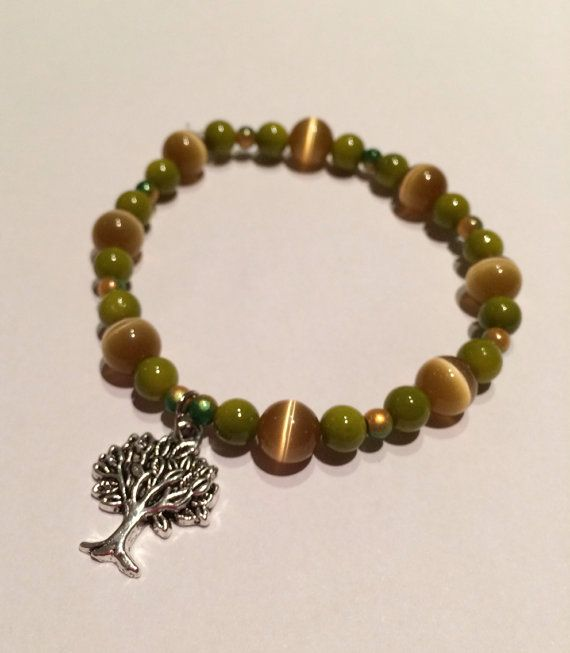 Earthy green bracelet with tigers eye beads and tree charm on Etsy, $12.00 AUD