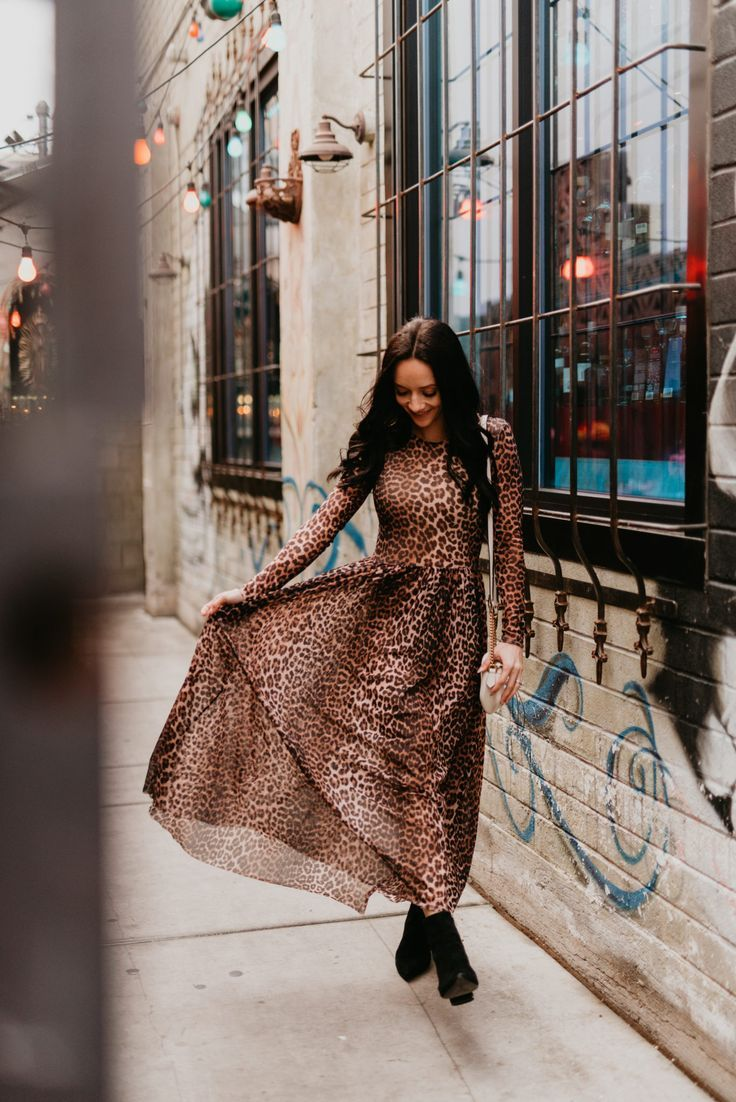 0cf5dae3 Animal print maxi dress featured by top US fashion blog, Outfits & Outings:  image of a woman wearing a Ganni leopard maxi dress, Marc Fisher booties  and a ...