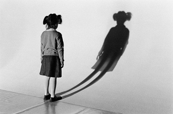 """Once the shadow was born, however, our self-expression became stifled and more serious. We learned from our parents, teachers, friends, and society that to win love and acceptance we had to adhere to certain prewritten scripts."" - Debbie Ford, The Shadow Effect (Elliott Erwitt)"