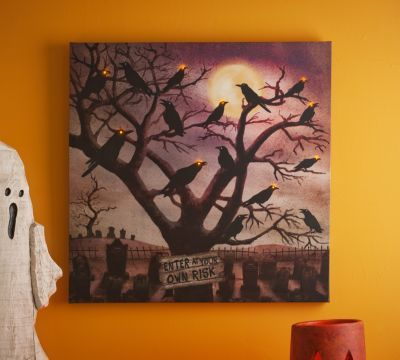 "Spooky Crows LED Canvas Art Print | Kirkland's Sale Item #: 118528 $34.99 The print captures a frightful view of a twisted tree riddled with crows. Glowing with embedded LED lights, this spooky scene warns ""Enter at your own risk""! 24L x 24H in. Required three (3) AA batteries; batteries not included. Comes ready for wall mount; no hanging hardware required!"