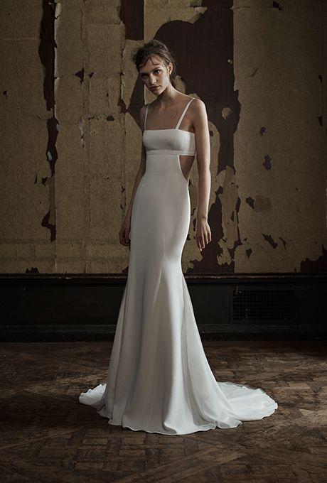 A sexy bandeau-style @verawanggang wedding dress with cutouts | Brides.com