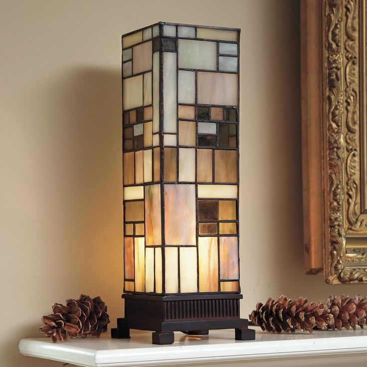 """Arts and Crafts Stained Glass Lamp A pillar of light in warm earth tones. Lamp is crafted in classic Tiffany style, with 134 pieces of hand-cut stained glass joined by copper foil. Cast resin base. 5""""w x 14""""h x 5""""d. Inline switch. Takes a 40-watt candelabra bulb."""