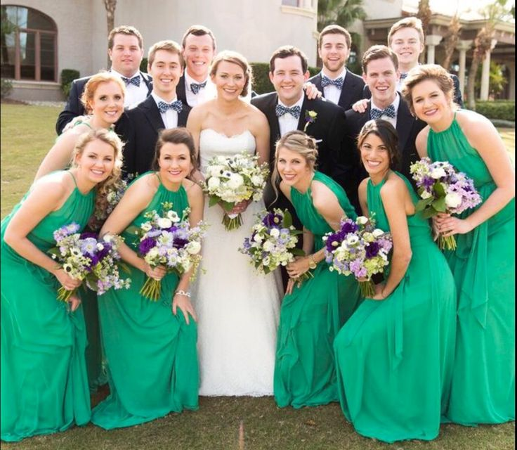 the bridesmaids wore kelly green and carried semi structured bouquets of green hydrangea, lavender scabiosa, white ranunculus, lavender stock,  purple lisianthus, lavender, white anemones & lemon leaf wrapped in cream satin ribbon