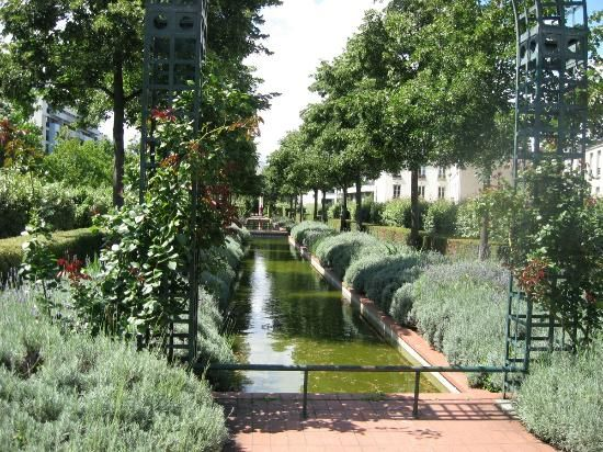 Viaduc des Arts,  Paris - Old viaduct turned into gardens and walkway on top and ateliers and shops beneath in the arcades