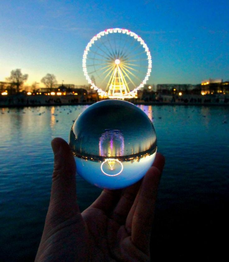 La grande roue du Tuileries Garden - Derossi Laurent, a Parisian photographer, photographing monuments, squares and other locations in Paris through a glass ball. He then shares his photos on his profile Instagram .  By Laurent Derossi