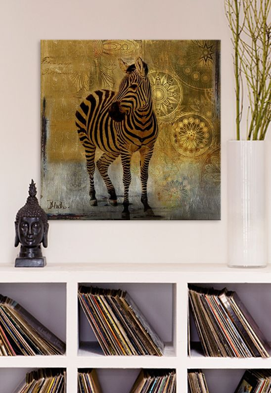 Zebra Expedition artwork, by Patricia Pinto. Originally from Columbia, Patricia Pinto's 25 years of experience as a sculptor, muralist, and professional painter is evident in her diverse art collection. She incorporates beautiful retro style designs, nature, and wildlife painting, creating unique layering and textures. Spruce up your house with this eclectic canvases, framed of artwork, a perfect gift for the traveler, which fits in perfectly with a Bohemian space.