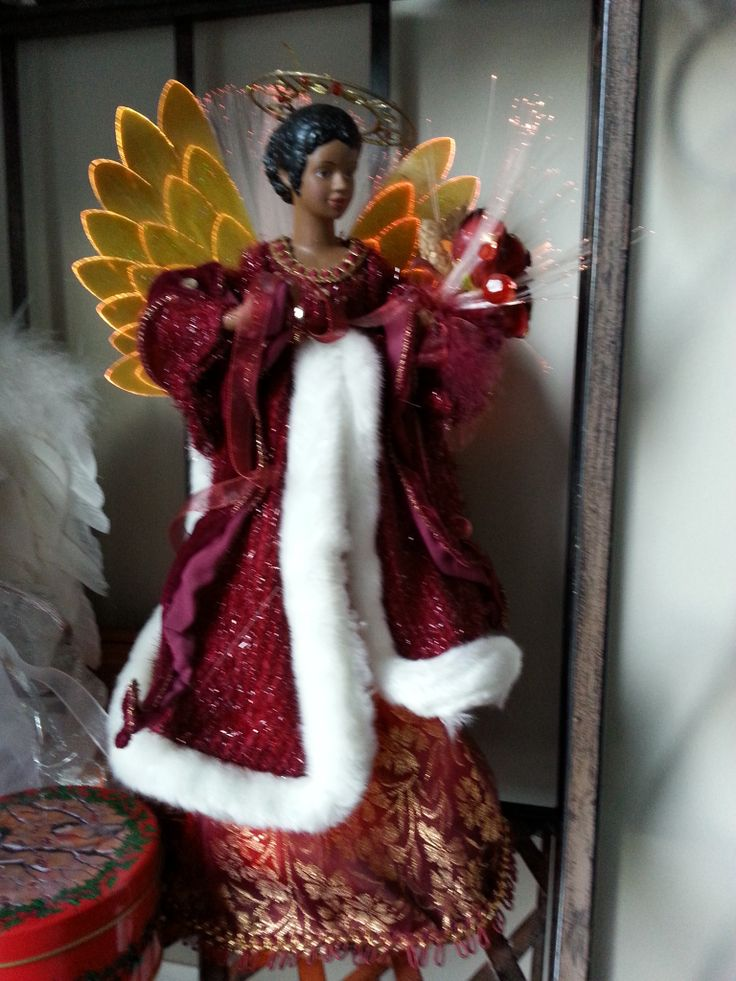 My African angel was the first one I bought for my collection. I love my multi-cultural angels. www.christinelindsay.org