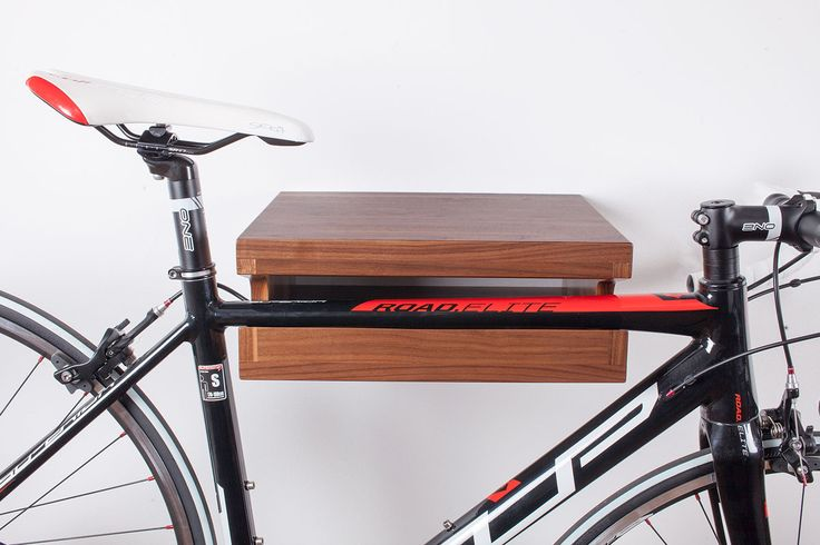 """Warm color with shade and light on solid Black Walnut wood leave no one indifferent. Robust construction of the shelf will ensure that your bike """"sits"""" securely and  comfortably. Hand made in Croatia. www.wooc.hr"""