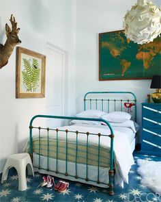 In the daughter's room, the vintage iron bed comes from a Marrakech flea market and the map is vintage.